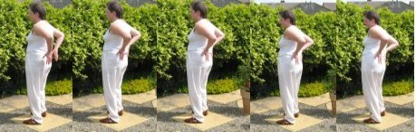 lower back exercise - beautiful woman turns the waist