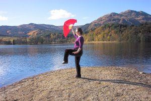 tai chi fan against Scottish loch
