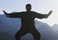 man doing qigong exercise